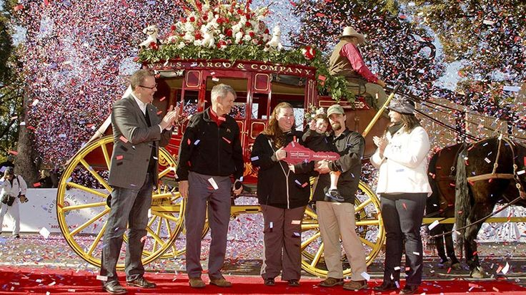 Team member Tyler Smith and CEO Tim Sloan joined Andrea Dellinger of the Military Warriors Support Foundation to award a mortgage-free home to Staff Sgt. Dominic Perrotte and his family at the 2015 Rose Parade.