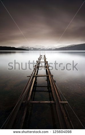 A long exposure of an abandoned jetty on the shores of Loch Lomond, Scotland
