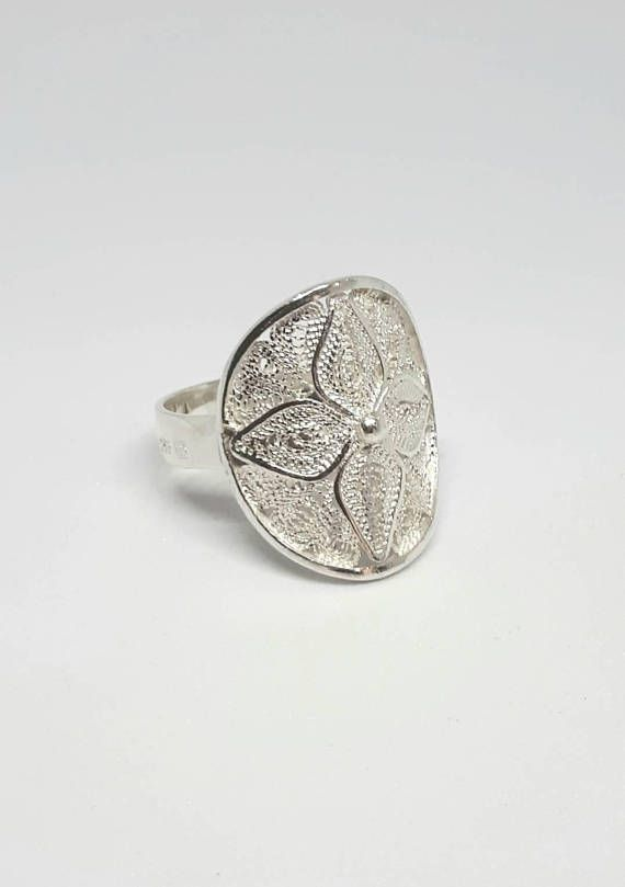 Check out this item in my Etsy shop https://www.etsy.com/uk/listing/499775874/filigree-ring-silver-ring-maltese