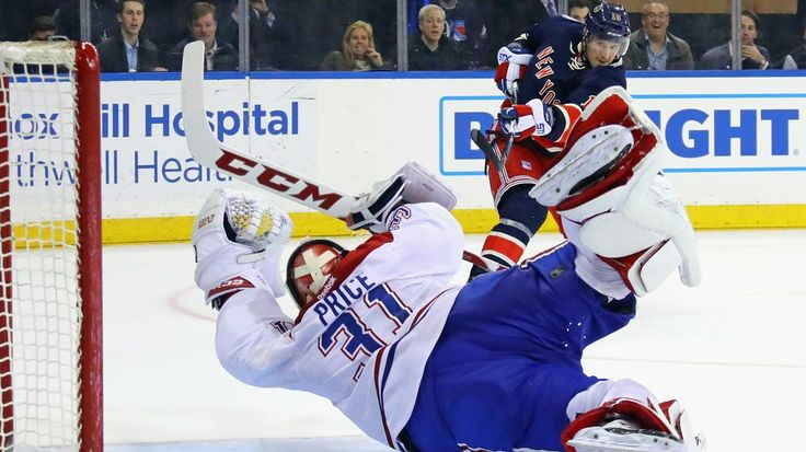 Carey Price makes a diving save against J.T. Miller.