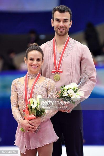 Meagan Duhamel and Eric Radford of Canada pose on...