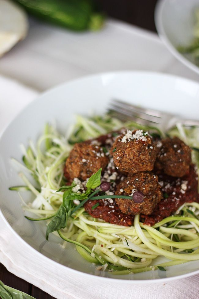 """Spaghetti & Veggie Balls -Made with lighter zucchini noodles, a rich sun-dried tomato sauce, and """"meat"""" balls made out of sunflower seeds and chopped full of veggies. Oh, and did I mention it's entirely raw & vegan"""