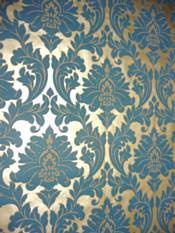 Teal & gold damask wallpaper. I want a chick cave. I would totally do this wallpaper on an accent wall