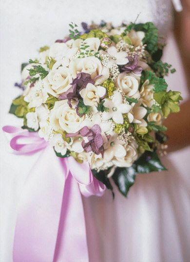 Innocence is my personal favorite of all my bouquets.  It's by far the hardest to make with its triangular shape all edged in garden ivy.  This bouquets takes between 60-80 hrs to create and will last forever.