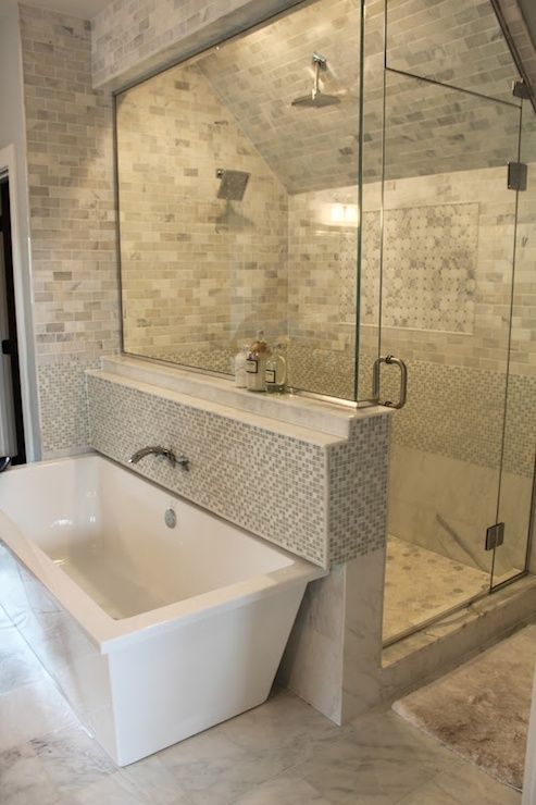 A chic contemporary attic bathroom with a walkin shower and modern tub.  Carrera marble throughout the shower.