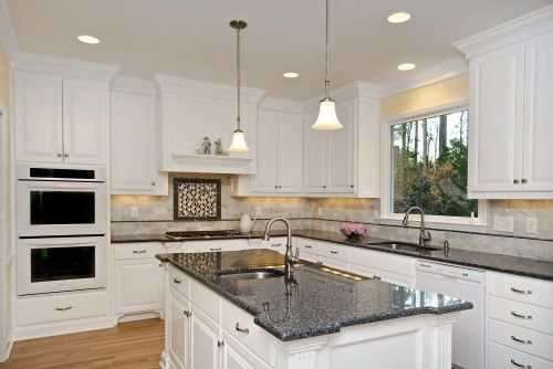 White Kitchen Black Granite white speckle countertops with black appliances | soft cream walls