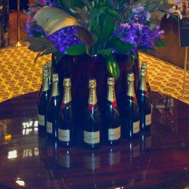 Moët bottles surround a floral arrangement. #champagne decor ideas