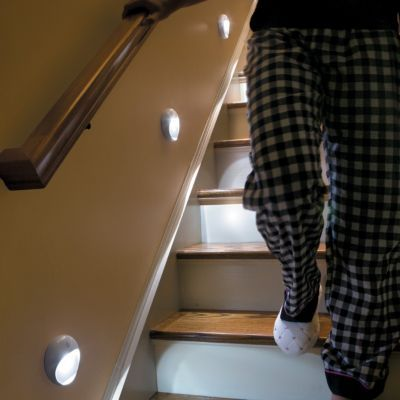 Wireless LED Stair Lights |  When you get within 6 feet of the first unit, the light comes on which then triggers the next unit to light as well. The PathLights Wireless LED Stair Lights stay on for about a minute, so you can safely make your way down dark staircases or halls. And since these motion sensor stair lights are battery operated, you can add them anywhere you need extra lights.
