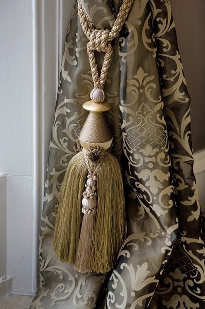 France dominated the art of the tassel in the 17th century. One tassel was often composed of up to six carved and covered wooden forms in a flat, faceted, dome or pear shape. These tassels incorporated ornaments and several different varieties of fringe, including inch, gimp, trellis, butterfly, tufted and swagged.    Even a simple French tassel during this time had at least 300 threads. This beautiful Nobilis-Fontan tassel would have found a home in any 17th-century sitting room.