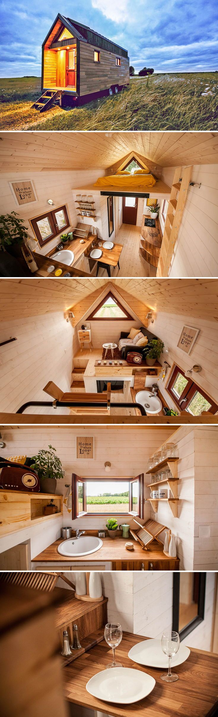 Based out of Nantes, France, tiny house company Baluchon created this custom 217-square-foot tiny house on wheels for their clients. The unique layout features an elevated living area above a short room that's used as a guest bedroom.