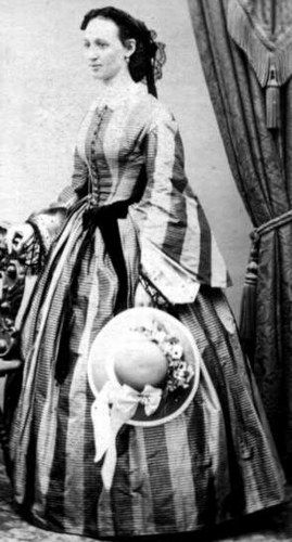 The late Civil War period saw an introduction of broad contrasting vertical stripes in women's clothing as seen here.