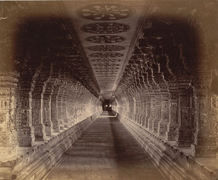 The long colonnade of the Ramalingeshvara Temple 1884 Photograph of a colonnade in the Ramalingeshvara Temple, Rameswaram in Tamil Nadu, taken by Nicholas and Company in c.1884, from the Archaeological Survey of India Collections. (via British Library)