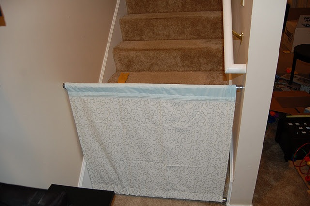 DIY baby gate (made of two shower rods and a fabric panel) to fit in awkward spaces that most baby gates won't. Smart!