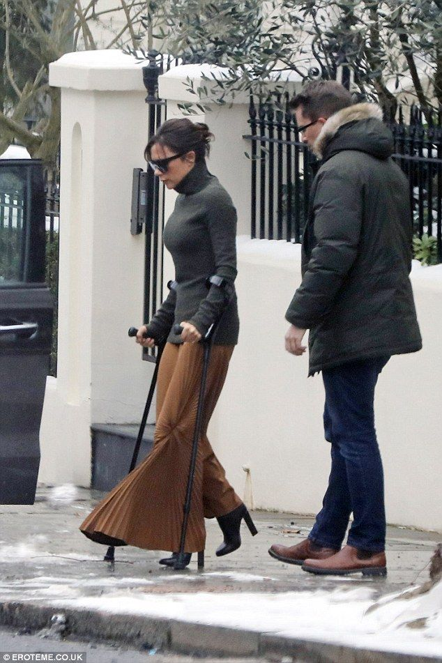Never Give Up (On The Good Times)! Victoria Beckham hobbled in the snow with crutches and high heeled boots in London on Friday before touched down in NYC