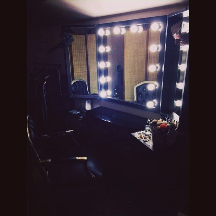 Huge opened makeup mirror with LED light bulbs and wings. All in pine wood painted in black :) http://zapproject.pl/