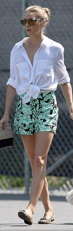 Olivia Palermo in Westward Leaning sunglasses, Zara green print shorts, and French Sole leopard print ballet flat shoes.