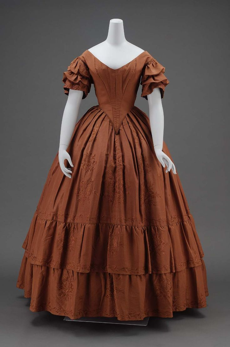 Dinner dress, about 1840, silk plain weave (faille) with silk embroidery, glazed cotton plain weave lining, and cotton plain weave gauze sleeve lining, cotton plain weave tape, baleen, metal hooks, accession number 52.1155, Museum of Fine Arts, Boston.