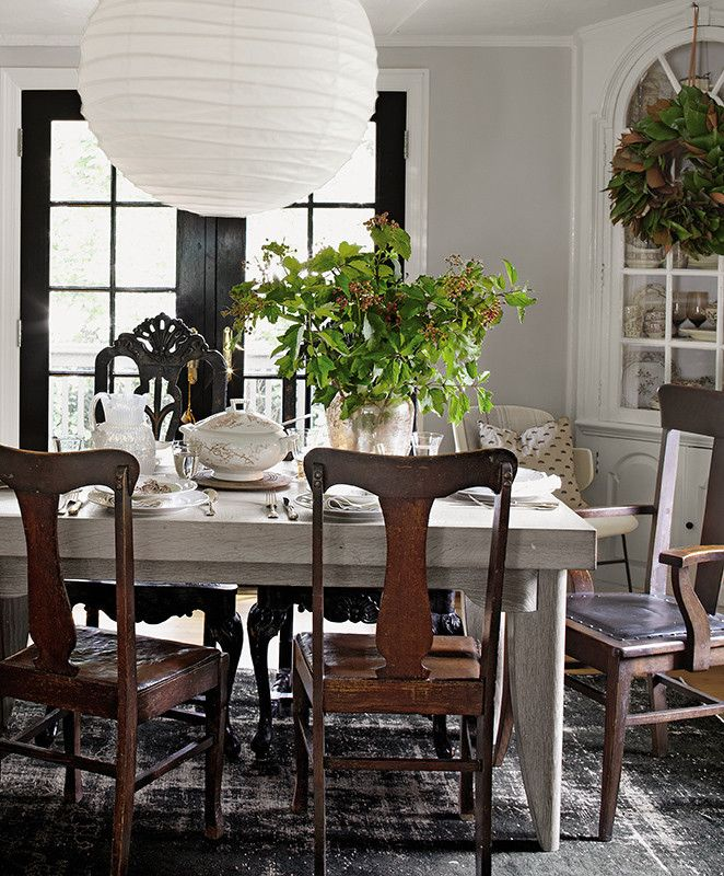 Mixing high and low is a decorating art form that can take years to truly master. One recipe we love: This chunky gray-stained farm table, formal chairs, and a paper Noguchi pendant light. Goodbye dorm decor, hello totally chic dining  room setup!