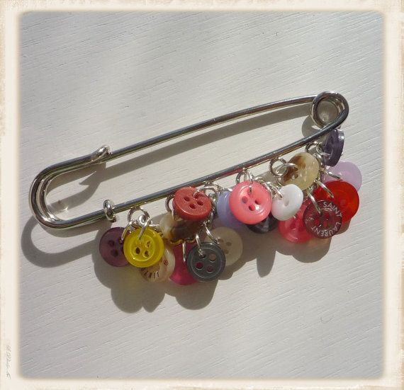 Buttons on an extra large safety pin...al la the 70's
