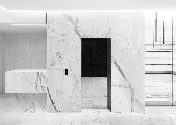 A monochrome palette of marble and concrete runs throughout the space, which is minimally furnished with designs by Modernists including Jacques Adnet, René Herbst and Marcel Breuer.