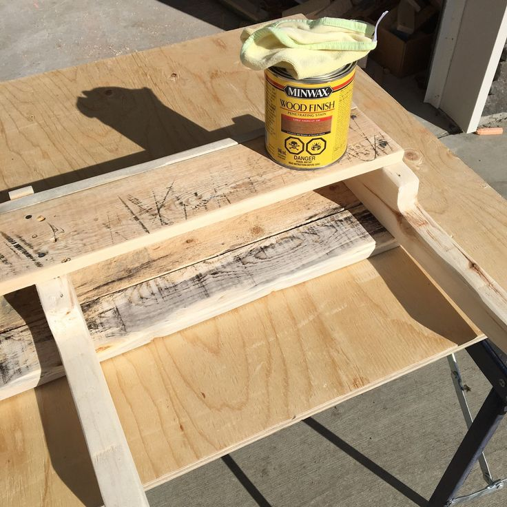 "Staining the rustic pallet wood wine rack with Minwax ""Early American"" stain."