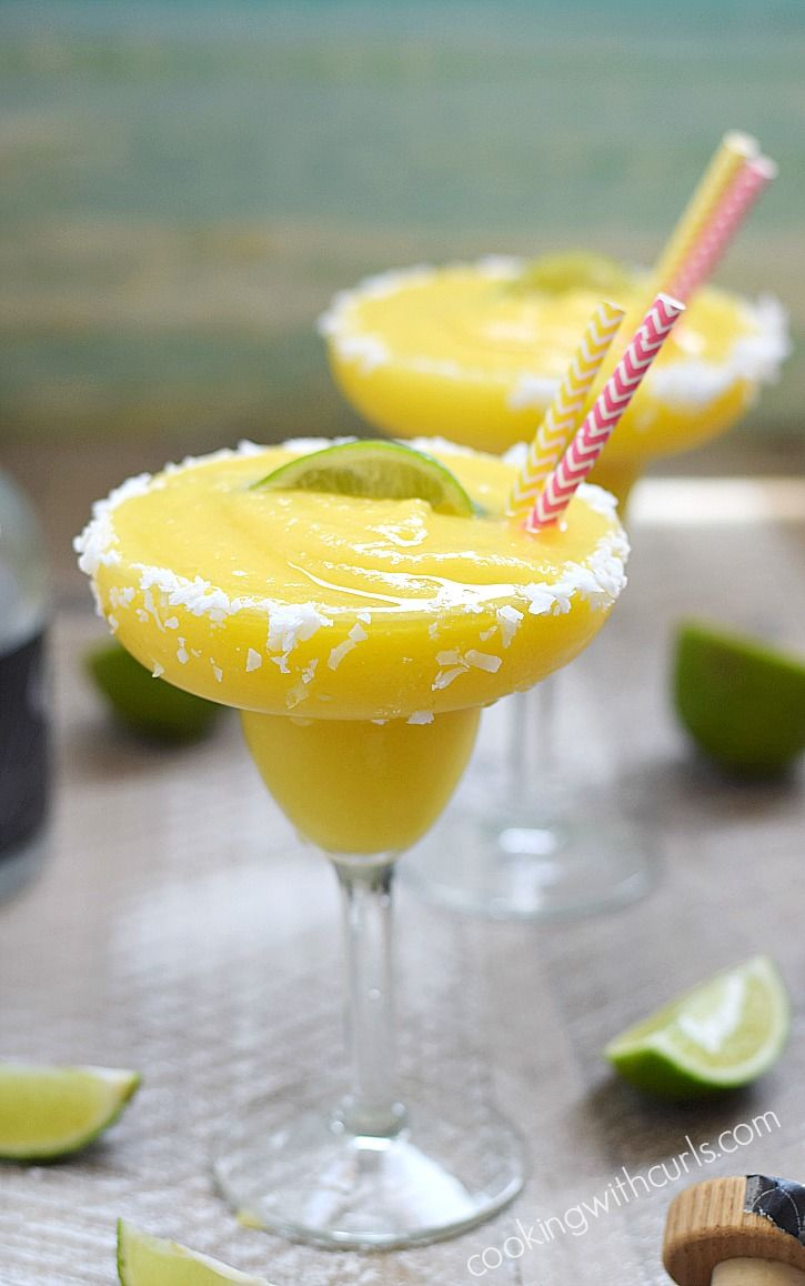 These Frozen Tropical Margaritas are like sunshine and ocean breezes in a coconut rimmed glass | cookingwithcurls.com