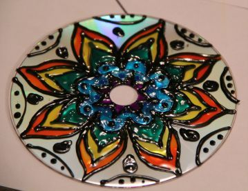 Sharpie and puffy paint CD mandalas - can't wait to make some with the girls this summer!