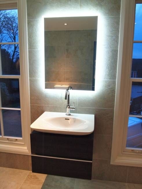 Classic bathroom mirror lighting by DeVal Bathrooms.