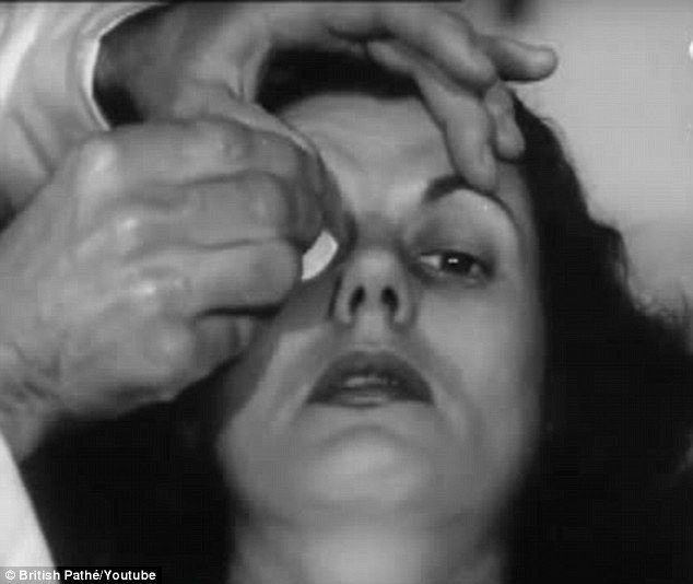 Footage from 1948 showsAustralia's only contact lens maker Penhryn Thomas making a pair on contact lenses for a woman (pictured)