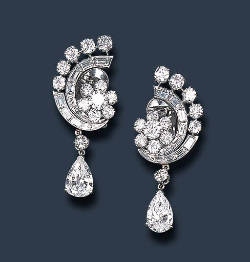 A PAIR OF DIAMOND EAR PENDANTS, BY VAN CLEEF & ARPELS   Each suspending a pear-shaped diamond, weighing approximately 1.55 and 1.59 carats, by a diamond collet, from a circular-cut diamond floret surmount, enhanced by a circular and baguette-cut diamond scroll motif, mounted in platinum  Signed Van Cleef & Arpels, N.Y., no. 22107