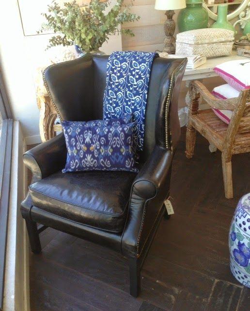 PORTOBELLO - HOME Black leather William wing back armchair with indigo bedspread