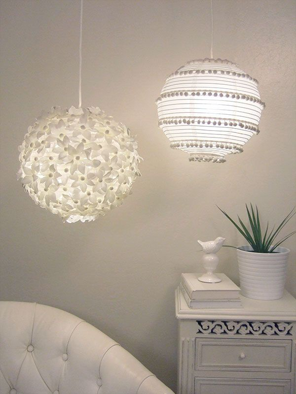Here are two more ideas for paper lanterns, one with flowers and one with pom-poms. | 24 Clever DIY Ways To Light Your Home