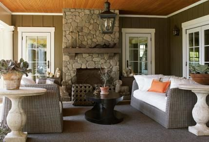Colors of wood and stone give the loggia a cozy feel for Garden loggia designs