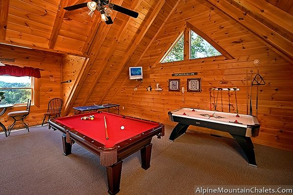 Lumberjack Rack -  Send the kids to the loft game area which has a full size pool table, and air hockey as well as a TV to watch sports games or movies as you pamper yourself in the outside hot tub after a day of hiking to the waterfalls.
