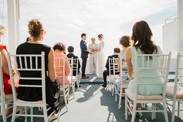 Intimate Wedding Venue Greece | Santorini Wedding by Stella and Moscha - Exclusive Greek Island Weddings | Photo by Anna Roussos | www.stellaandmoscha.com