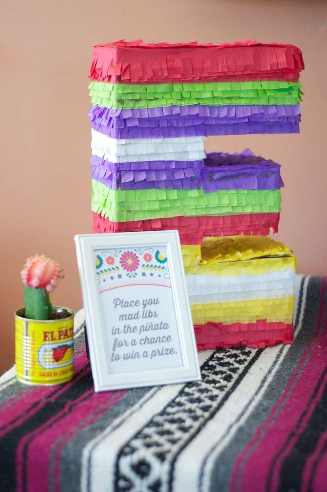 Colorful pinata at a fiesta bridal shower party! See more party planning ideas at CatchMyParty.com!