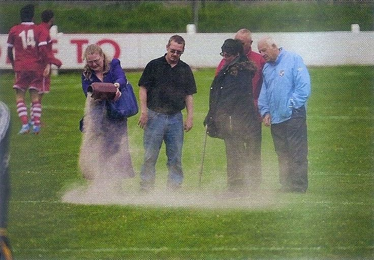 """Mrs Stout scatters her husband's ashes over the Dean Street pitch before the Shildon vs. Crook Town FA Cup game on Aug 16th, 2014, """"so he may never miss a match again"""". (From """"When Saturday Comes"""" magazine, Oct 2014 issue)."""