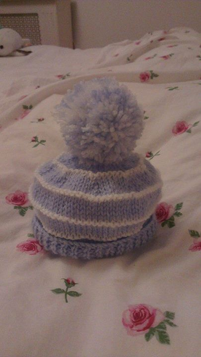newborn knitted baby hat, in double knit with bobble.