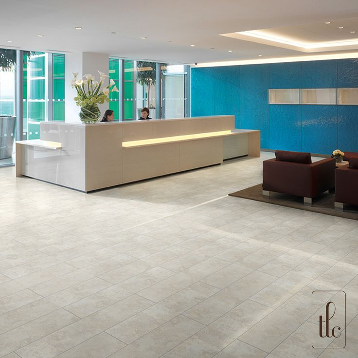 Limed Sandstone - 5281 -   With its cool tones and authentic detailing in each tile, Limed Sandstone is a classic floorcovering choice when it comes to heavy commercial spaces. The natural and realistic decoration creates a simple backdrop to any interior decoration, and the pale hues help reflect light.  (Two tiles laid together with a surrounding Grey Grouting Strip, brickwork effect.)