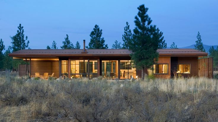 This vacation home in Washington state by Prentiss Balance Wickline encloses a courtyard within interlocking volumes clad in weathering steel.