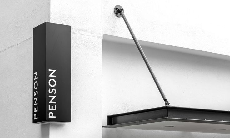 Penson Group signage and brand identity designed by She Was Only