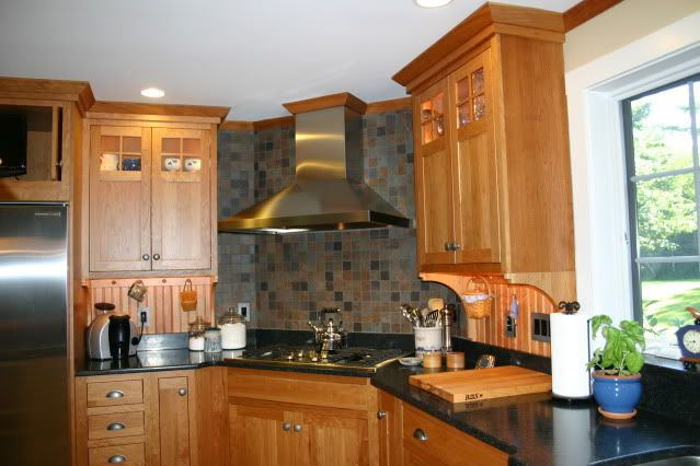 Kitchens with hoods in the corner we have a corner 5 for Corner cooktop designs kitchen