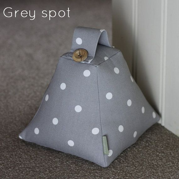 ♥ A beautiful handcrafted fabric doorstop perfect to compliment any room ♥ One doorstop (unfilled) will be supplied. Please choose from drop down list. ♥ Smoke Grey ♥ Taupe Beige ♥ Scottie Dog ♥ Red ♥ Pink ♥ Green ♥ These doorstops has been lovingly made from Shabby Chic Spotty fabric. It is an unusual pyramid shape with handle and two decorative buttons. Would make a great gift. Measurements - The square base is 17cm x 17cm and the height is 18cm (inc handle) The item is UNFILLED, to ke...