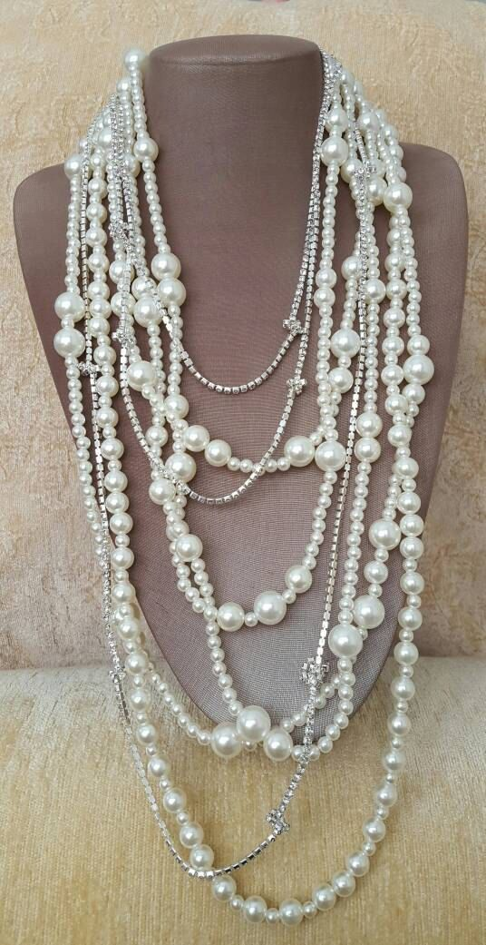 Check out this item in my Etsy shop https://www.etsy.com/ca/listing/496522720/long-multistrand-pearl-rhinestone