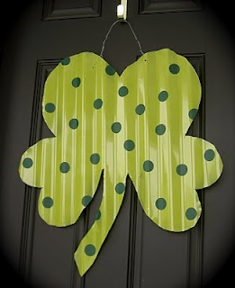 This is sooo cute, I want to make one.  She uses corrugated roof tin to make a shamrock and a heart