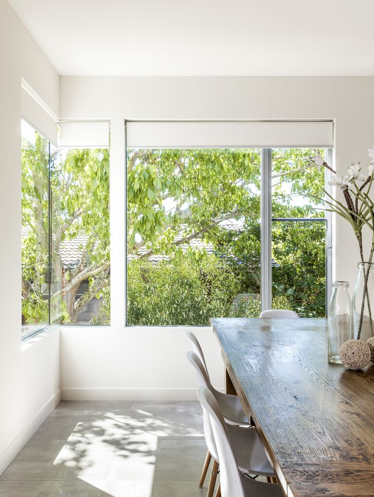 A&L sashless aluminium windows and corner window. Frameless sashes create a modern, minimalist look.