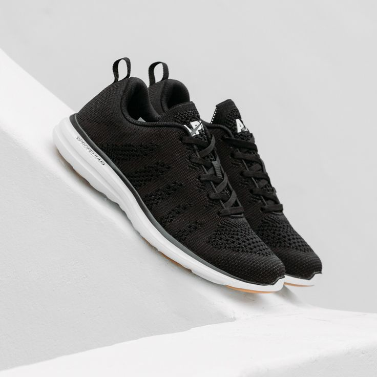 The APL® TechLoom Pro in Black/White/Gum is the latest version of the classic APL running shoe that started a movement. The one piece woven upper that features innovative performance textiles creates a truly intriguing visual of different knit patterns, color palettes, levels of depth, and intricacy not seen in other footwear. Cushioning is provided by our new Propelium® midsole/outsole for extreme comfort and clean looks. The TechLoom Pro is truly where fashion and athletics i...