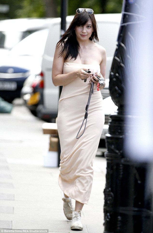 Summer style: Daisy Lowe, 27, flashed some skin in a nude bandeau dress while heading out in London's uncharacteristic sun-soaked weather on Monday