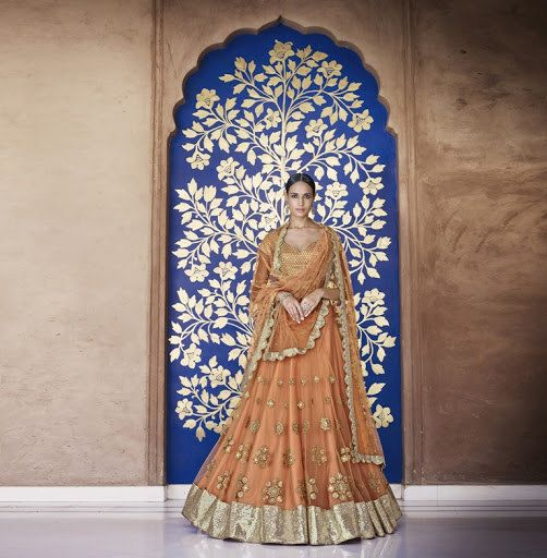 This is a Bollywood Indian Designer Saree or Lehenga made from Faux Georgette fabric, Blow The Beauty winds with this Peach Wedding Designer