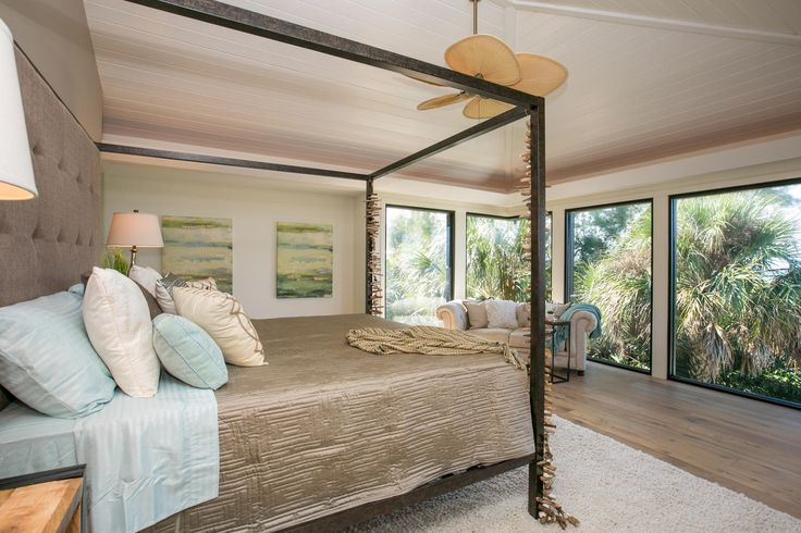 Beach themed bedroom brings that sandy sun bleached feel from the drift wood to decor. Huge windows capture the lush garden for that inside outside feel.   Yellowfish House is a new property located on the white, sandy beaches of Anna Maria Island, Florida.